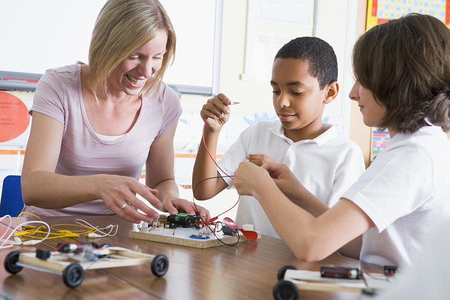 Schoolchildren and their teacher in a science class